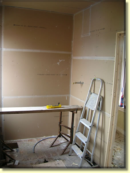 Plumbing completed new walls are plaster boarded on this for Bathroom ideas belfast